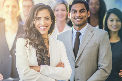 Real estate agents standing and looking at camera