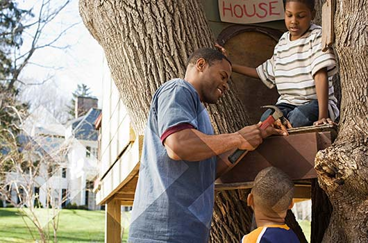 Home Equity Loan - Family repairing their tree house.