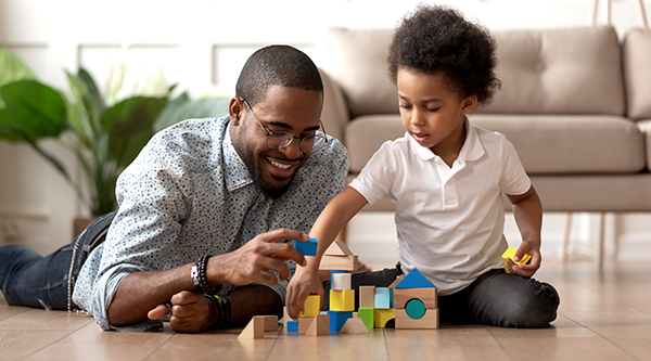 Image of adult and child playing with building blocks