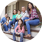 extended family sitting on the front door steps - refinance