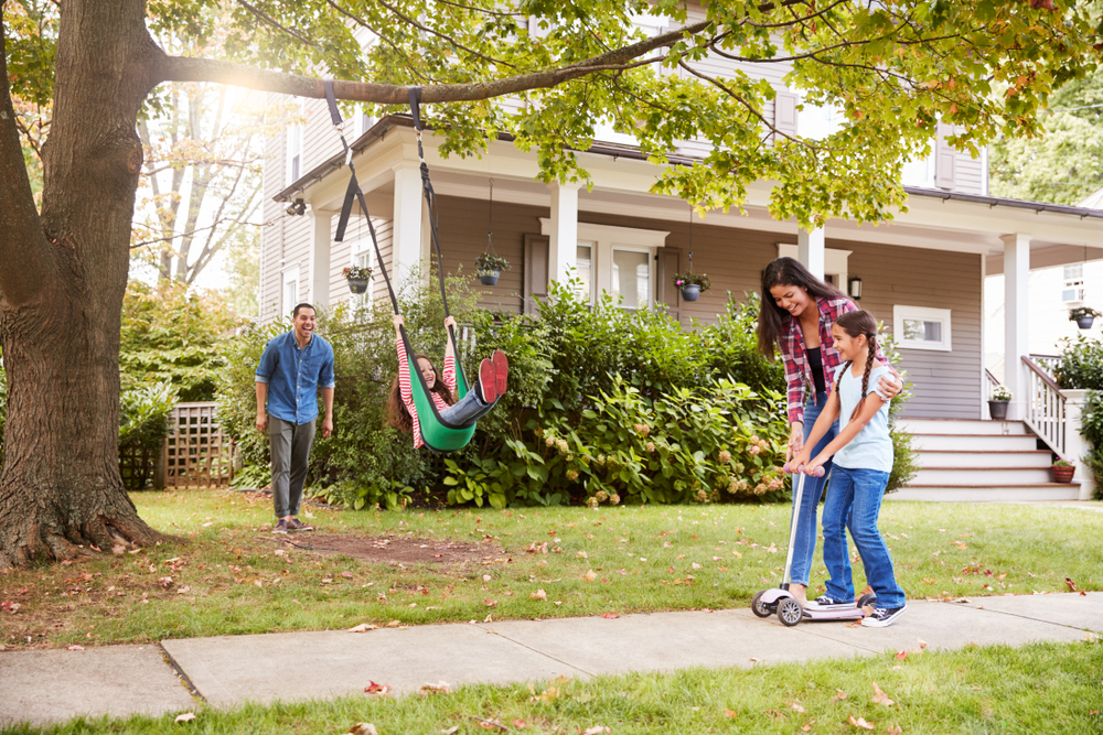 family and dog running through the yard - types of home loans