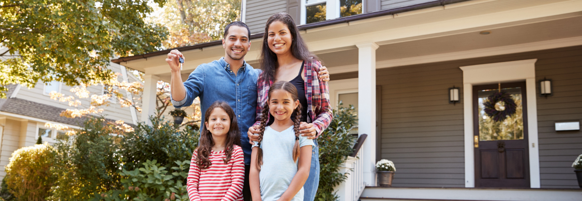 Picture of Hispanic Family of Four in Front of Home