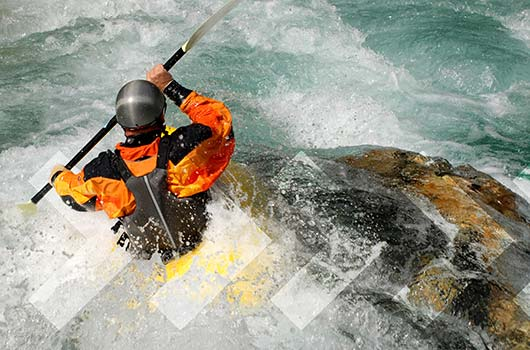 Home Equity Line of Credit - Adventurer kayaking river rapids.