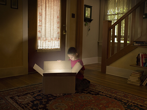 boy looking into a shining box - home buying learning center