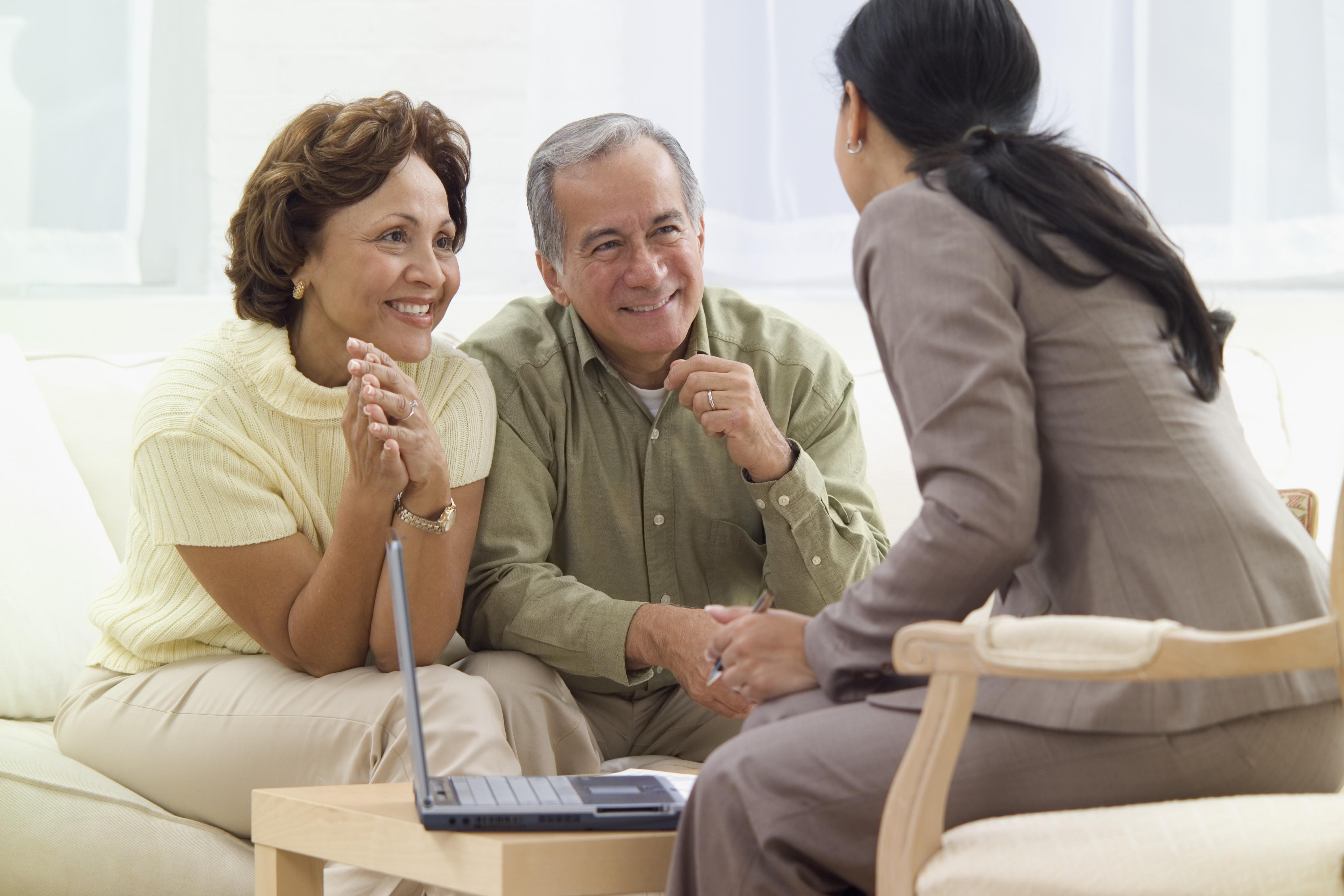 Elderly couple talking to loan officer