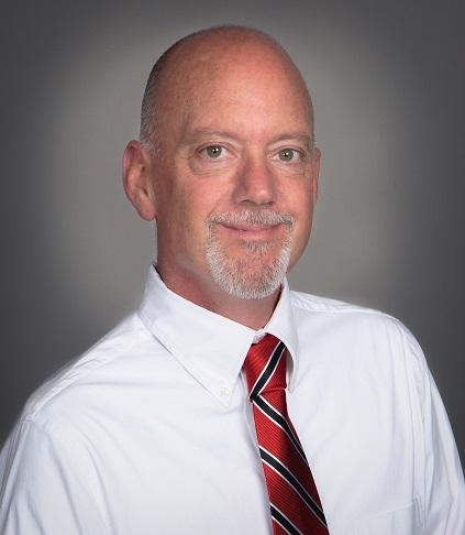 A headshot of Ken Savoie
