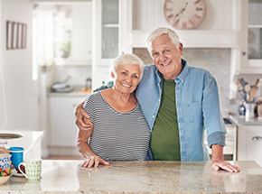 A couple smiling after their kitchen refinance