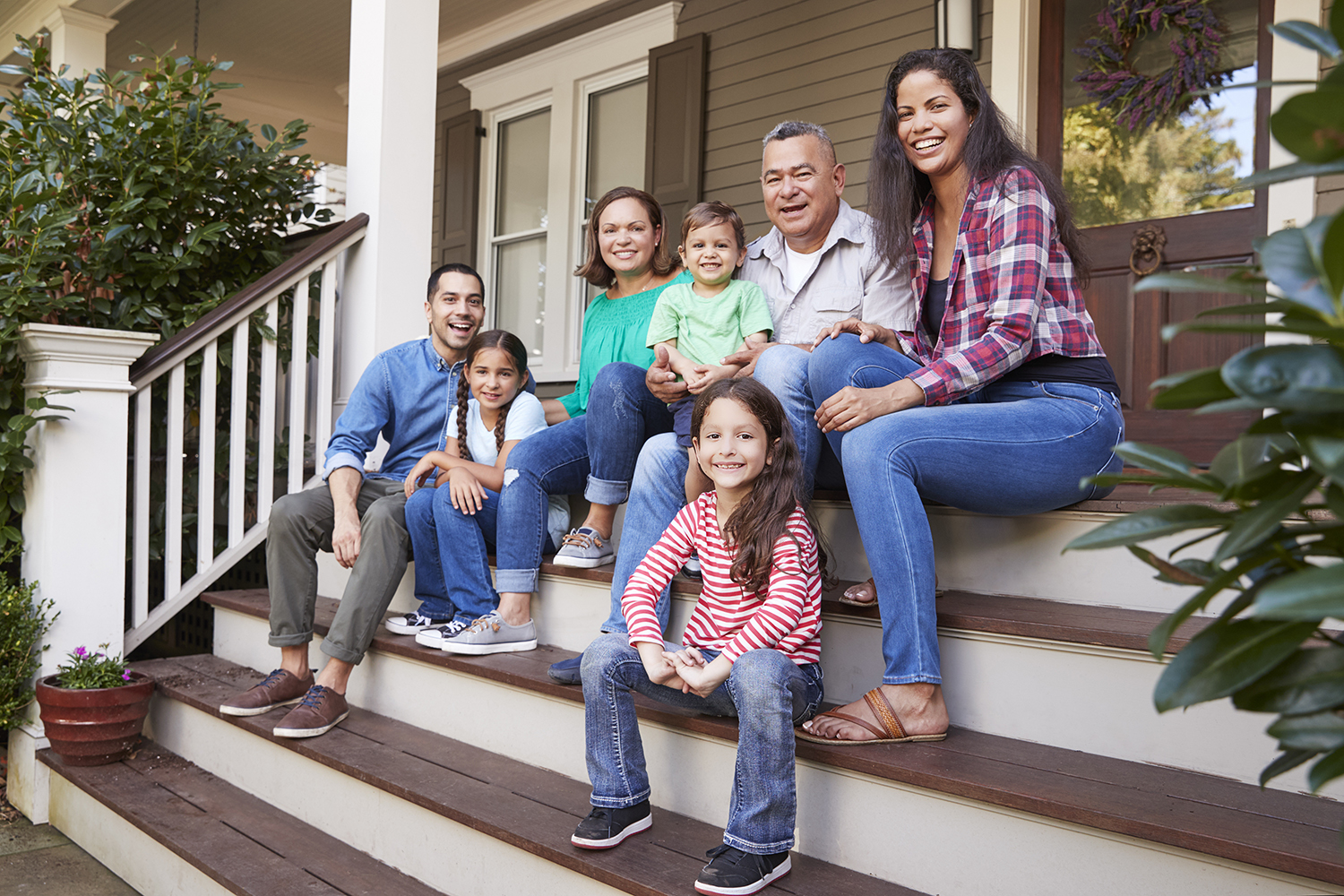Extended family sitting on the front door steps - Types of loans