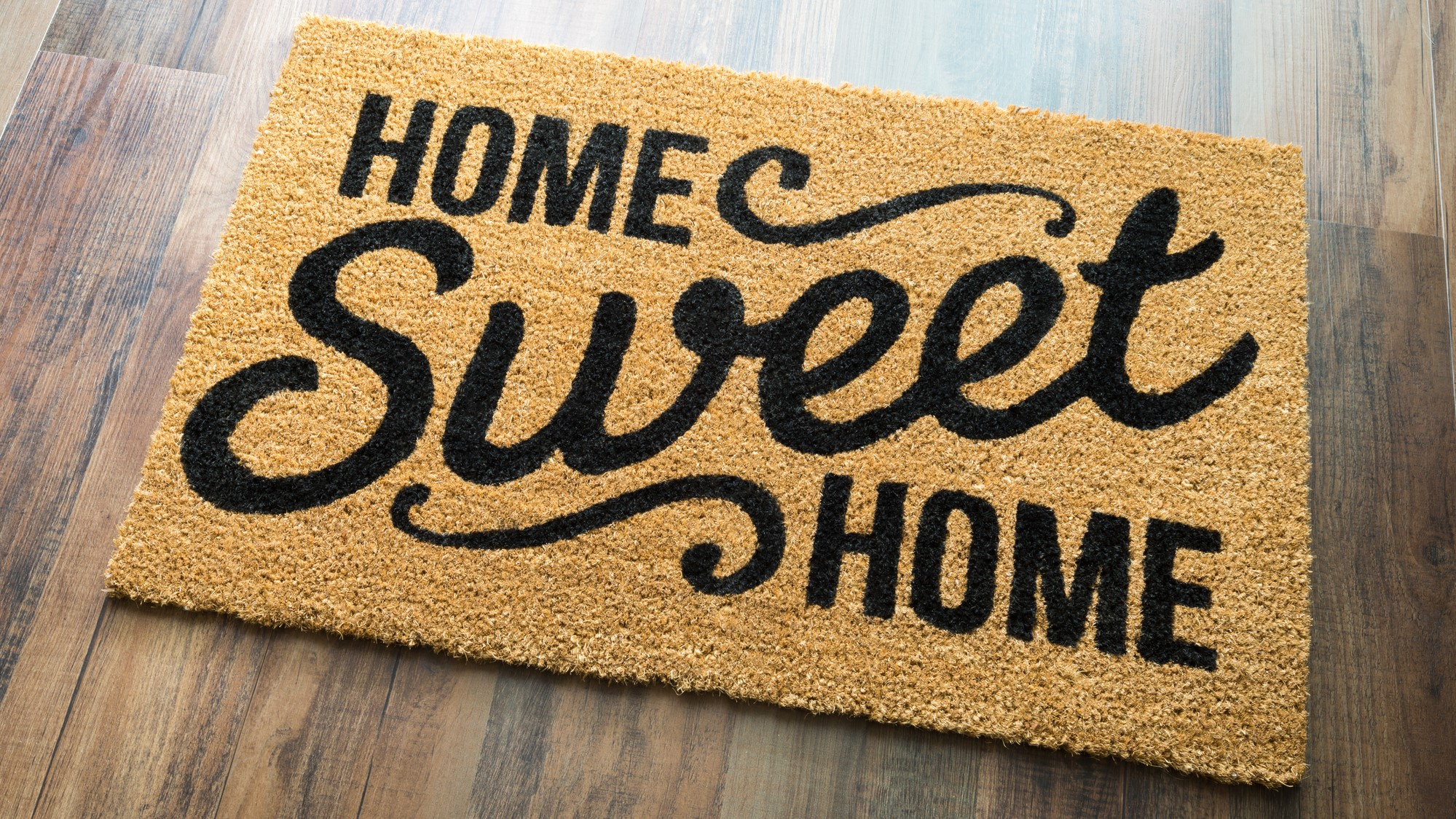 Image of doormat with the words home sweet home