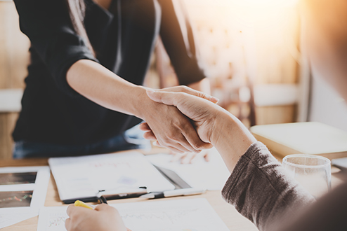 A handshake from a trusted mortgage adviser and lender