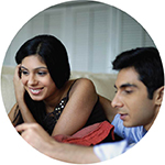 young couple on a couch - refinance