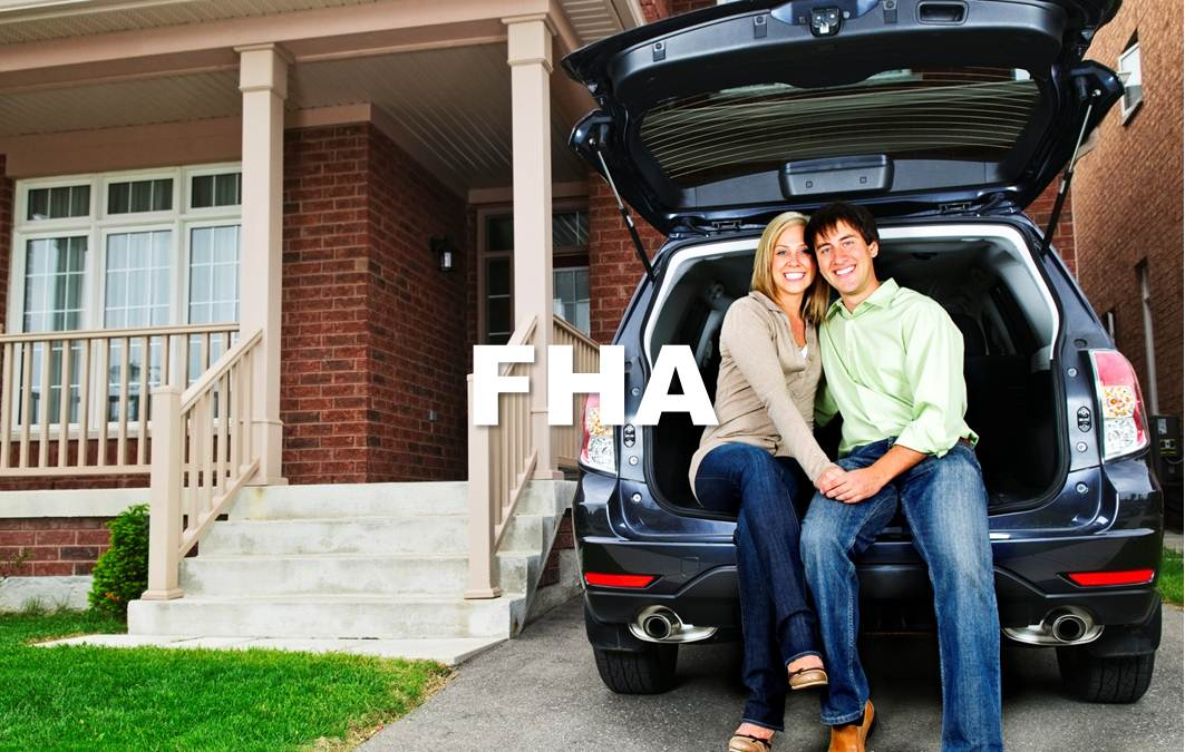 picture of couple sitting in the trunk of a car in front of home