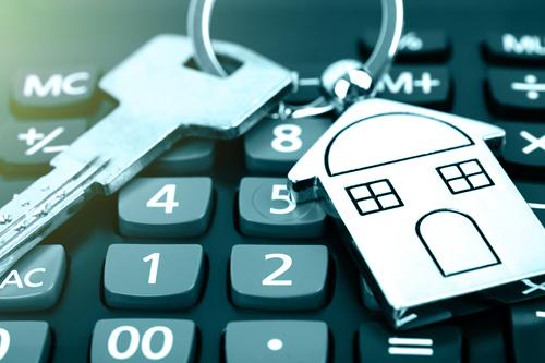 House keys sitting on a calculator