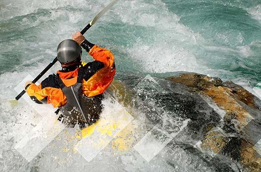 Home Equity Line of Credit - Adventurer kayaking river rapids.