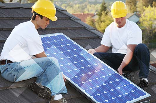 Solar Energy Loan - Professionals installing solar panels.