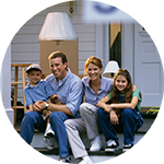 Family of four sitting on the front door steps - Refinance